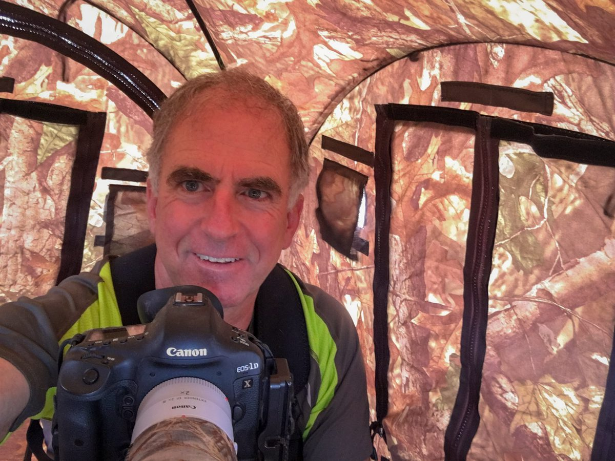 Photographer Ed MacKerrow inside a photo blind