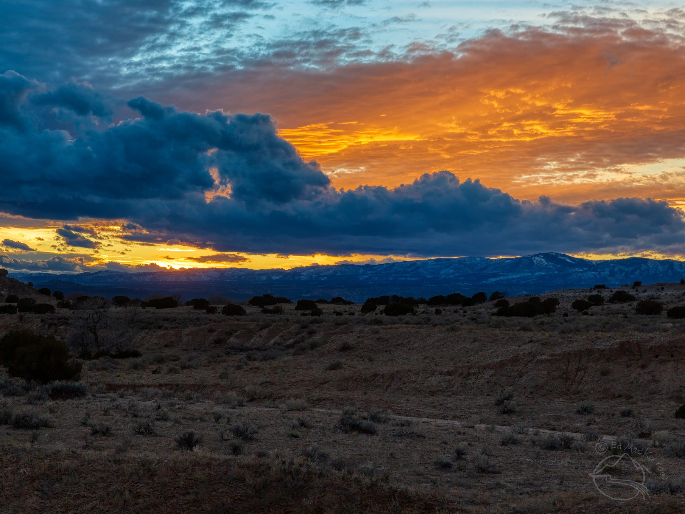 Stratocumulus clouds under cirrostratus clouds at sunset in New Mexico